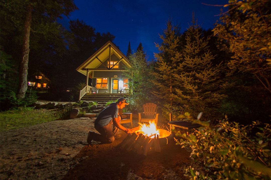 Man making a fire near from Chalet Nature in Parc national du Mont-Tremblant