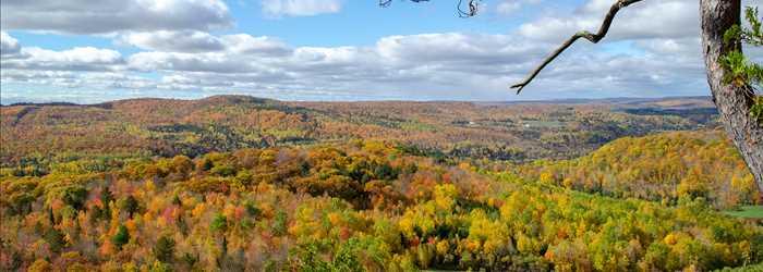 View of the Auberge de la Montagne Coupe in autumn