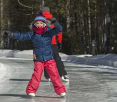 Little girl in skating at Parc des Pionniers in Saint-Donat