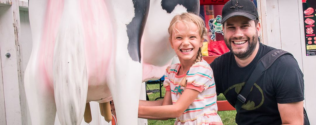 A father and his daughter at the Rive-Nord Regional Agricultural Show