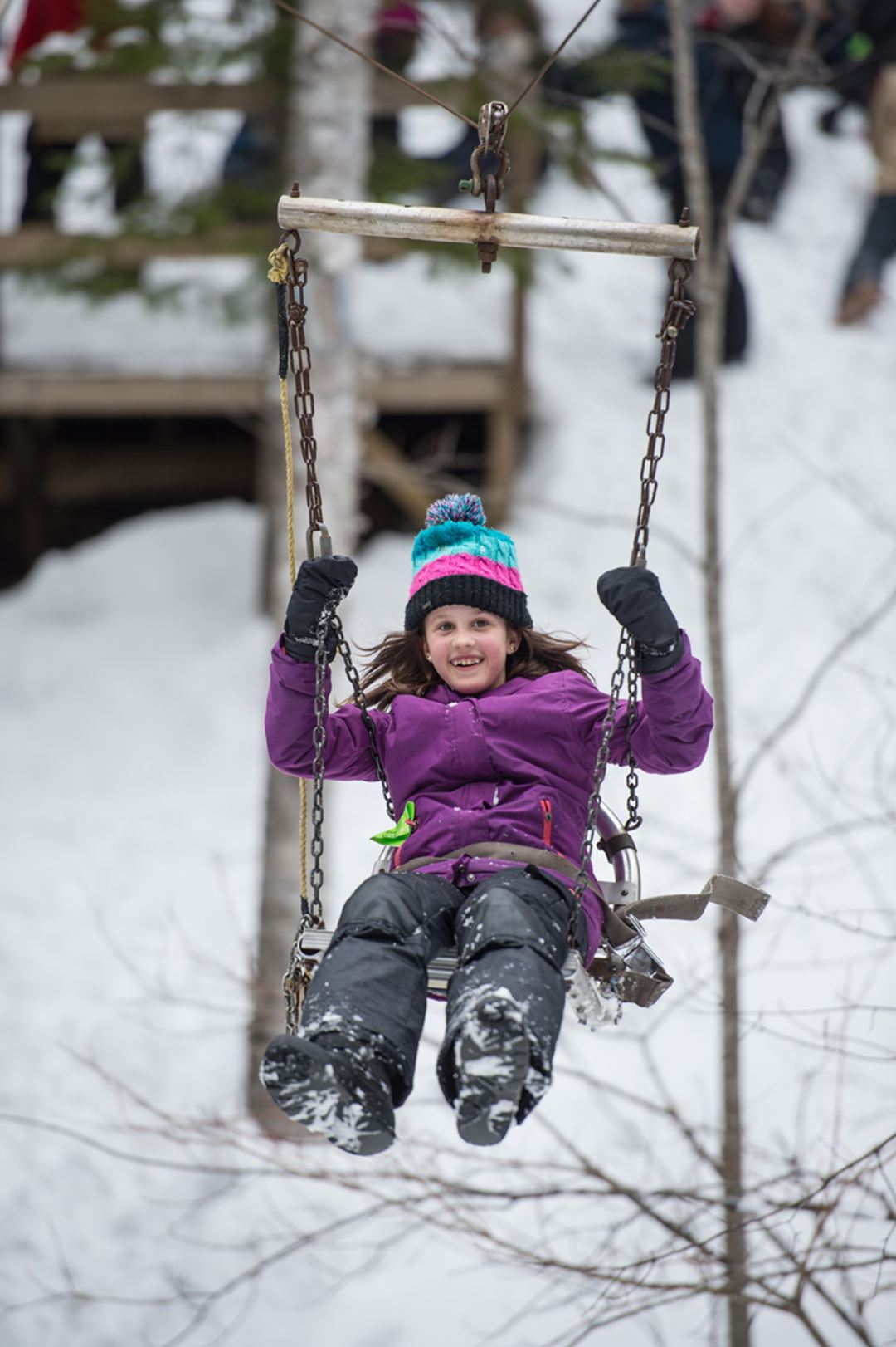 A little girl doing a swing at Havre Familial