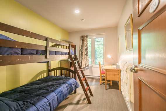 Room with bunk beds at Chalet Quatre-Saisons