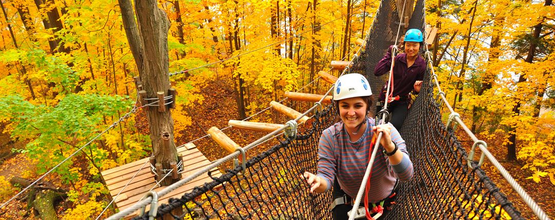 Two girls in tree walks in Arbraska in fall