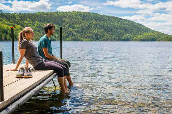 Two people on the pier at Parc national du Mont-Tremblant