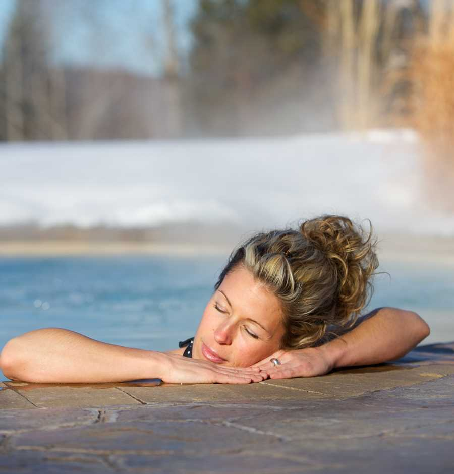 Woman relaxing at La Source Bains Nordiques outside