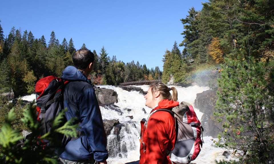 Couple laughing in front of a fall at Parc régional des Chutes Monte-à-Peine-et-des-Dalles