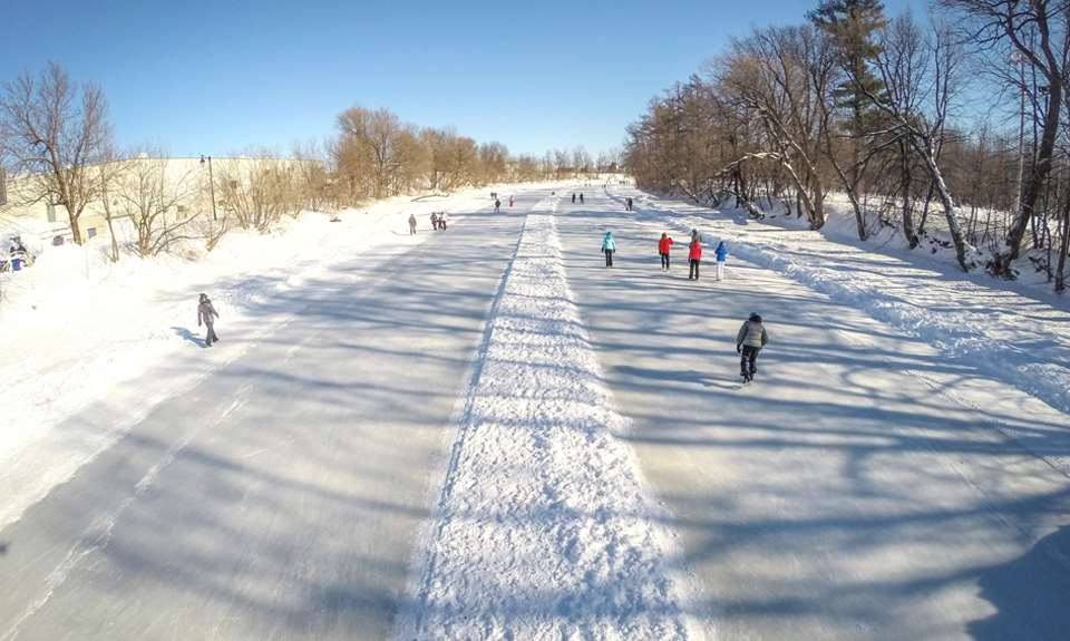 People ice-skating on Rivière l'Assomption