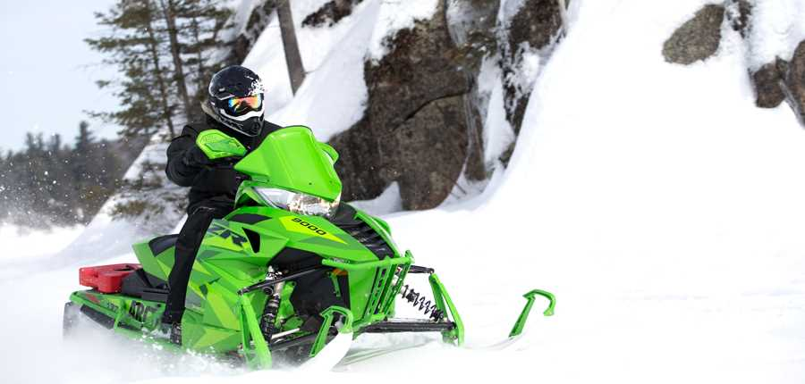 Person doing snowmobile outside during winter