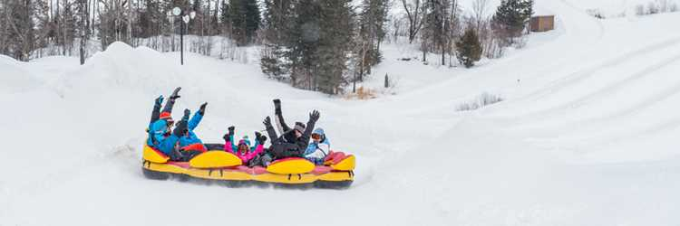 Kids having fun at  Super glissades Saint-Jean-de-Matha