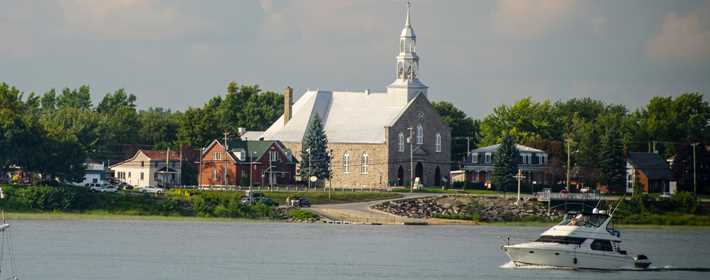 Outside view on the river and the boat and church on coast