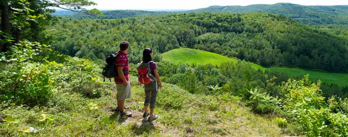 Couple hiking in the sector le Piémont during summer