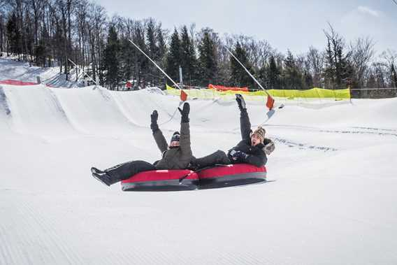 Couple at the slides during winter at Ski Montcalm