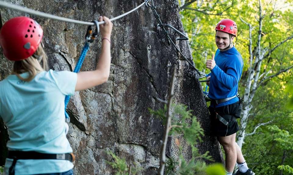 Two people on a rock wall in Arbraska