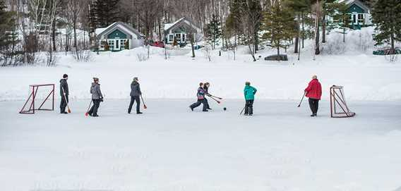 People playing broomball in winter at Le Havre Familial