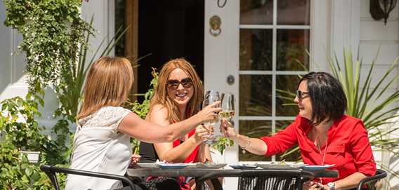 Three women drinking on a terrace in Joliette