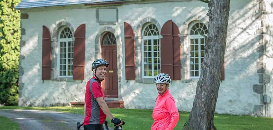 Cyclist in front of the Cuthbert Chapel
